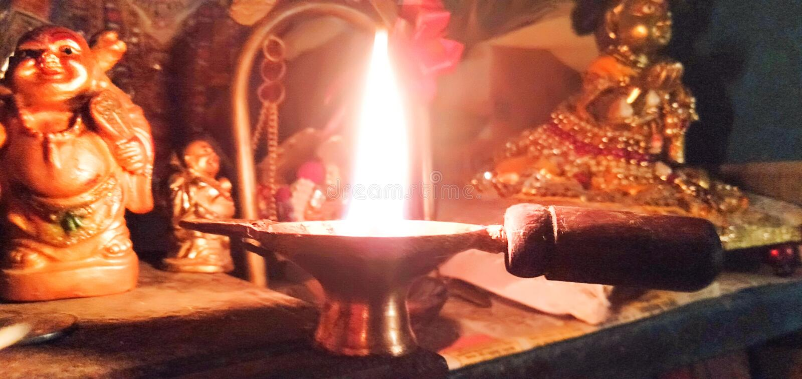 Evening light in the tample. Photo of the lamp that burns in the tample during the evening royalty free stock photography