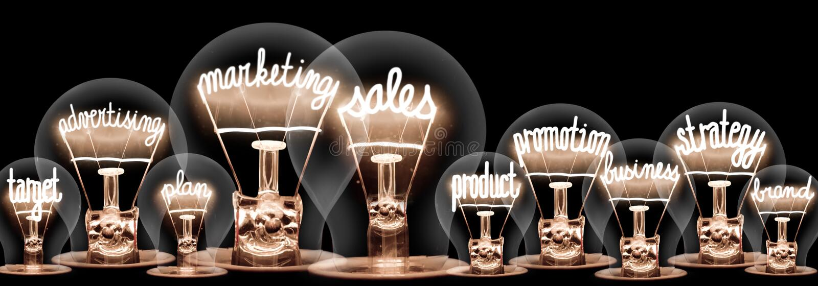 Light Bulbs with Marketing Sales Concept royalty free stock images