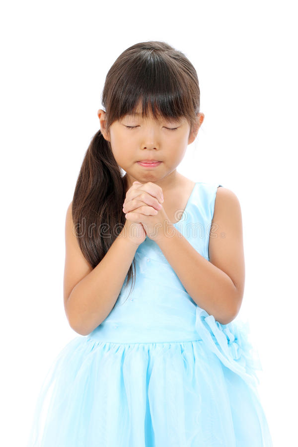 Photo of little asian girl praying