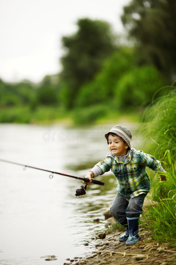 Photo of little boy fishing stock photo