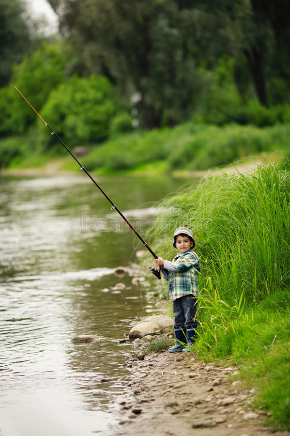 Photo Of Little Boy Fishing Stock Photography
