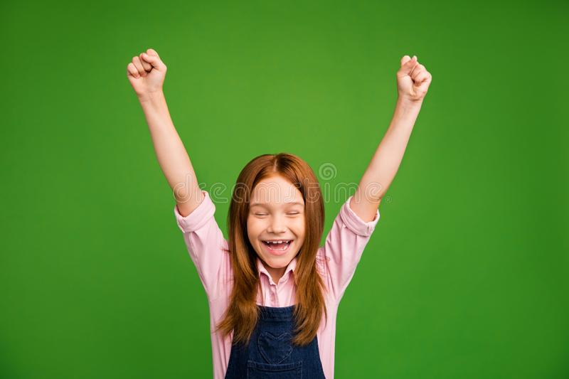 Photo of little crazy ginger schoolchild in front of blackboard celebrating raise fists rejoicing summer beginning wear. Photo of little crazy ginger schoolchild stock photo