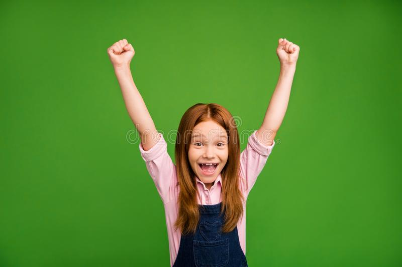 Photo of little ginger schoolchild in front of blackboard celebrating winning classmates team in sport competitions. Photo of little ginger schoolchild in front stock image