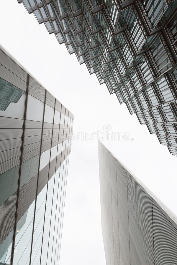 A photo looking up capturing three different buildings on an angle. Creating a T shape negative space stock photos