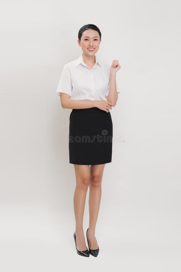 Photo lumineuse d'hôtesse heureuse et souriante image stock