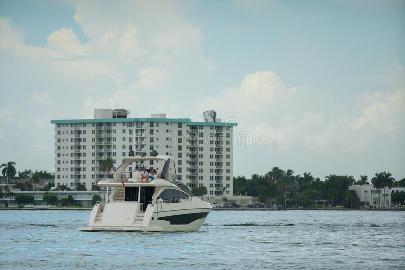 Photo of a luxury yacht in Miami with buildings in the background stock photo