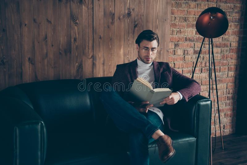 Photo of macho business guy holding hands corporate book reading article about famous chiefs wear specs stylish blazer. Photo of macho business guy holding hands royalty free stock photos