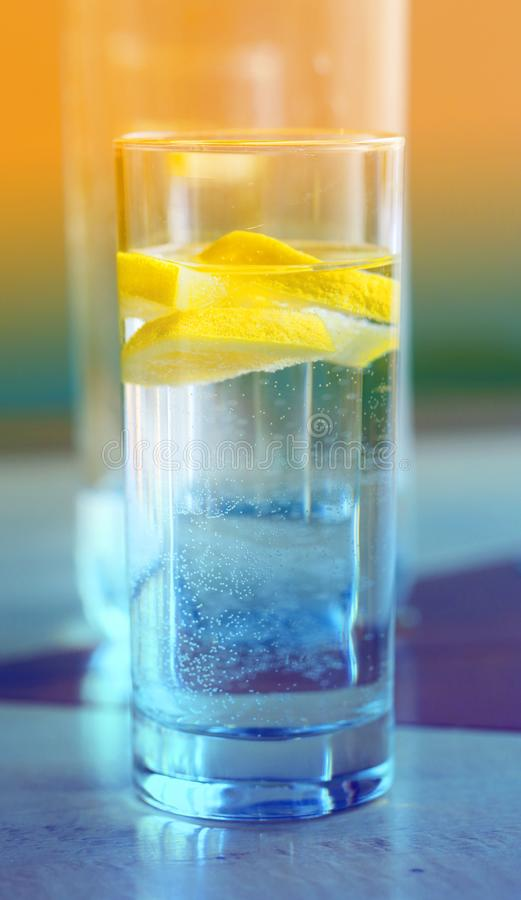 Photo of macro clear water with lemon in a glass Cup stock photos