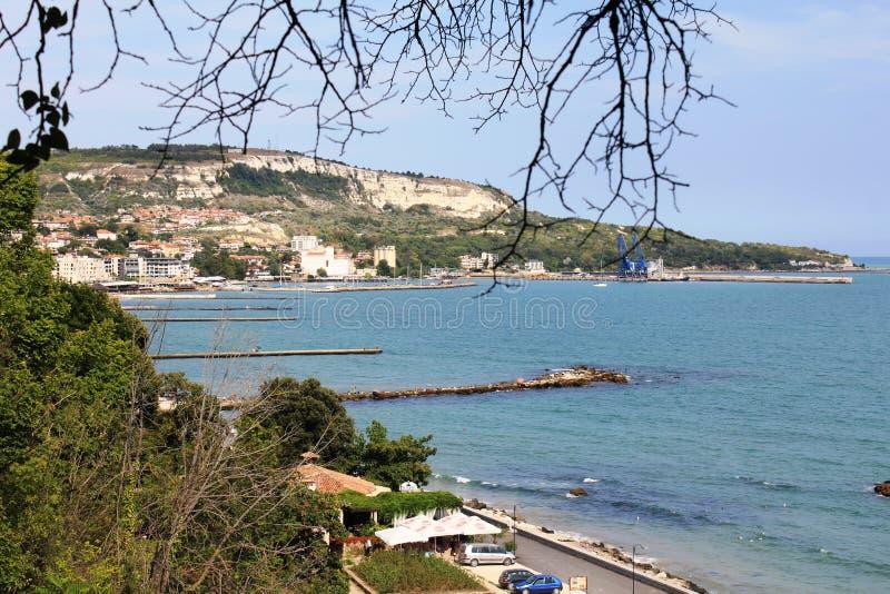The coastline in Balchik, Bulgaria. Photo made in Balchik, Bulgaria at the Black Sea. Whire rocks, little port, many hotels and long pronenade royalty free stock photography
