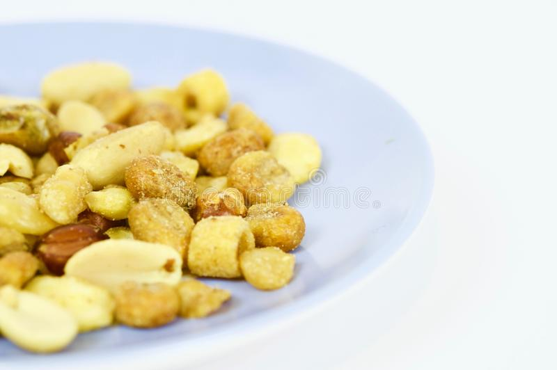 Roasted nuts ready to eat. Photo made with macro objective and in isolated background of nuts. Ideal photo to illustrate diets, healthy lifestyles, etc stock images