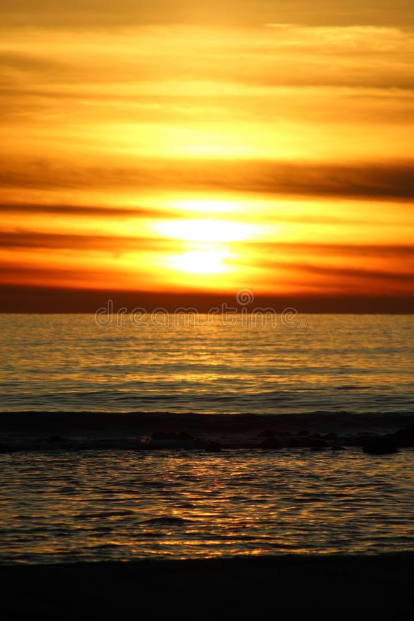 The afternoon walk at the beach with the view f the sunset. This photo is made in Marina di Massa, Italy during the sunset. you can see the beautiful colors royalty free stock photo