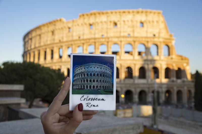 Photo of the magnet with whole Colosseum with real colosseum on stock photography