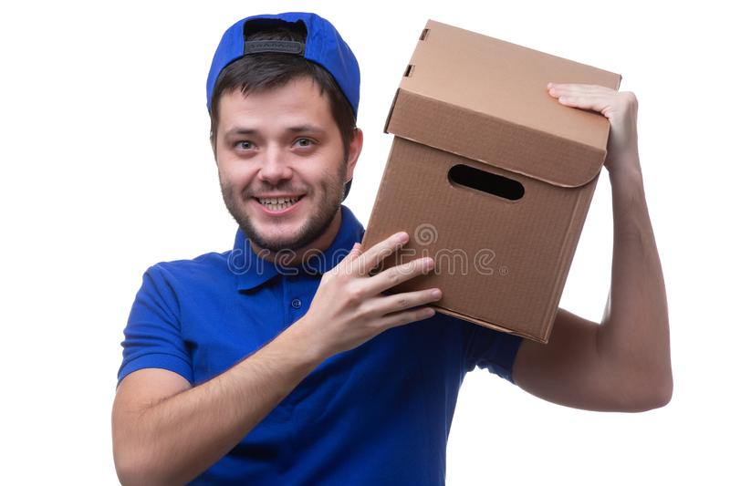 Photo of man in blue t-shirt and baseball cap with cardboard box royalty free stock photography
