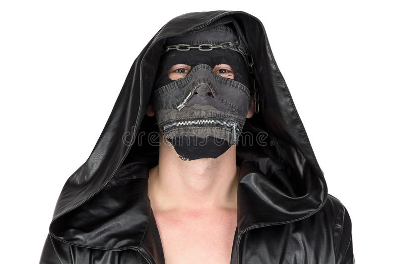 Photo of the man dressed in hooded cloak. On white background royalty free stock photo