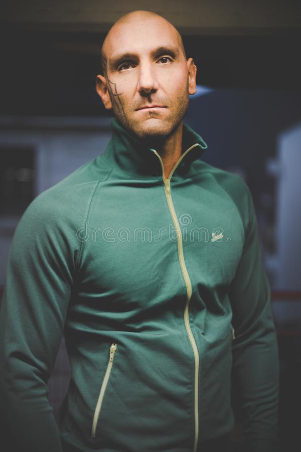 Photo of Man in Green Zip-up Jacket royalty free stock image