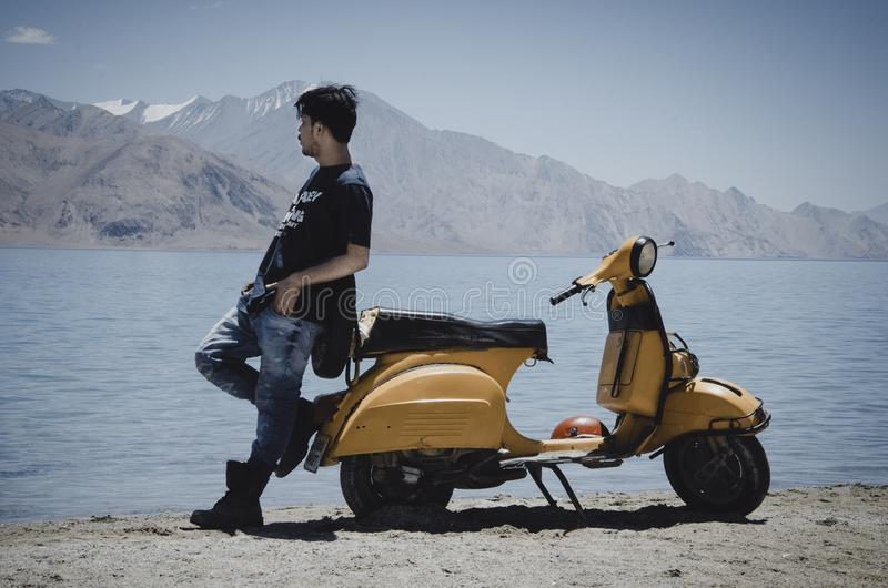 Photo of Man Leaning on Motorcycle stock photo