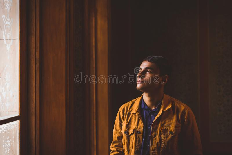 Photo of Man Looking Towards Window royalty free stock photos