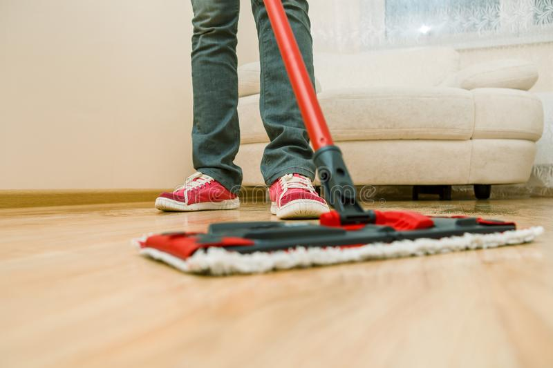 Photo of man`s feet with mop washer floor stock image