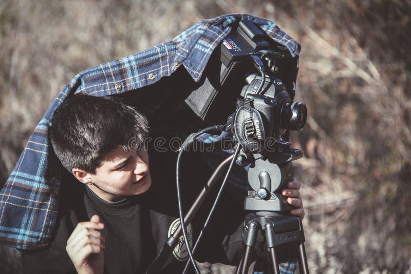 Photo of Man Setting Up Dslr Camera on Tripod royalty free stock photography