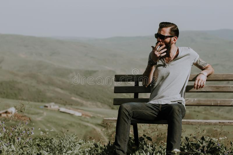 Photo of a Man Sitting on Wooden Bench royalty free stock image