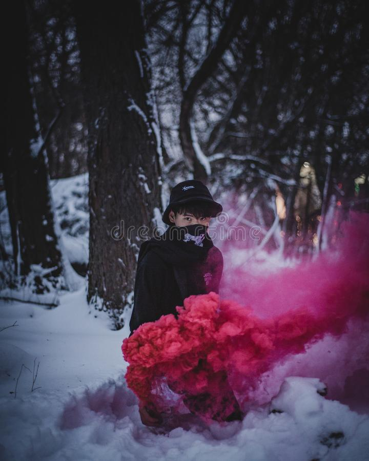 Photo of Man Surrounded by Red Smoke royalty free stock images