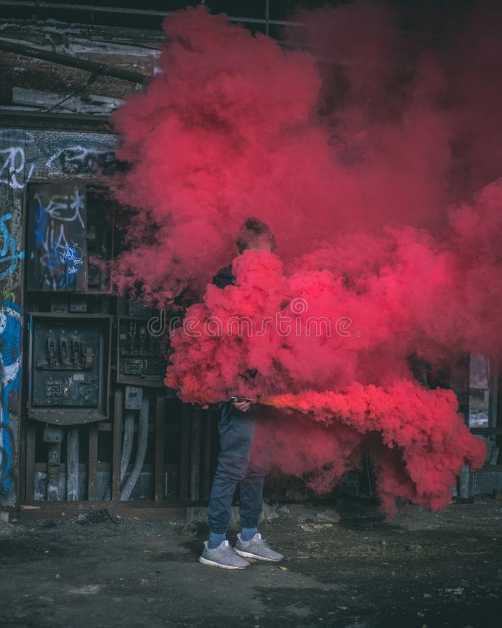 Photo of Man Surrounded by Red Smoke royalty free stock photography