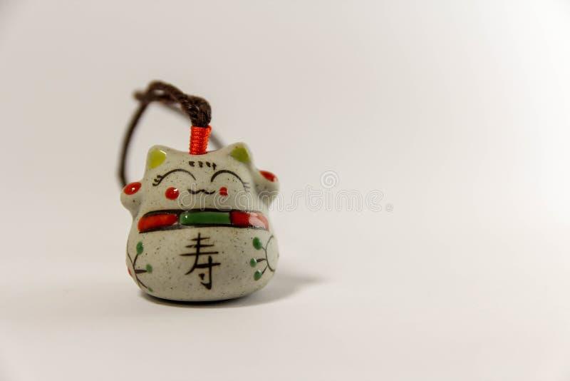 Maneki Neko - Japanese welcoming cat - with clipping path stock images