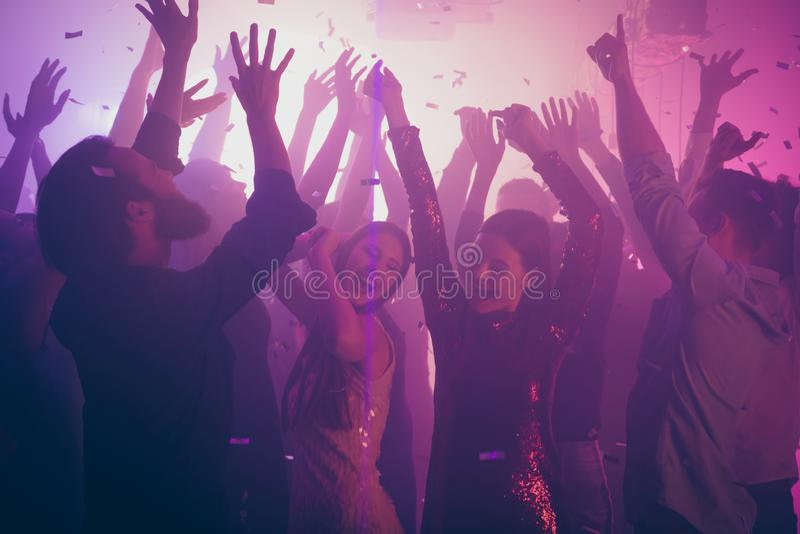 Photo of many birthday amazing people dancing students life purple lights confetti flying nightclub hands raised shiny stock photos