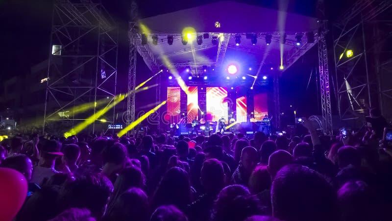 Photo of many people enjoying rock concert stock photo