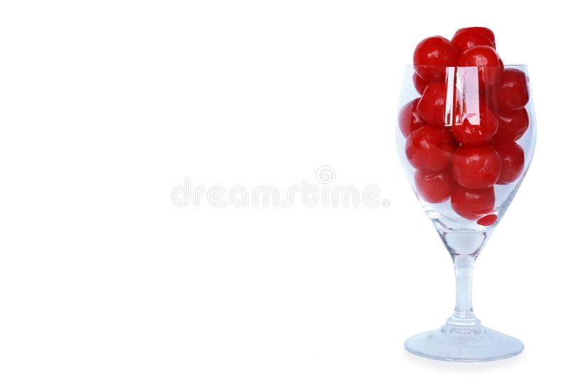 Closeup of maraschino cherries on a champagne glass stock images