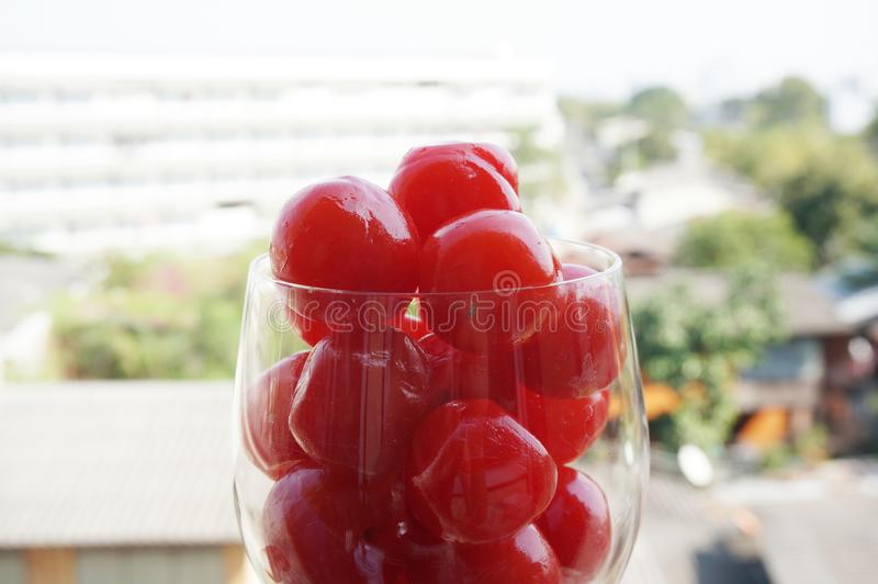Closeup of maraschino cherries on a champagne glass stock photography
