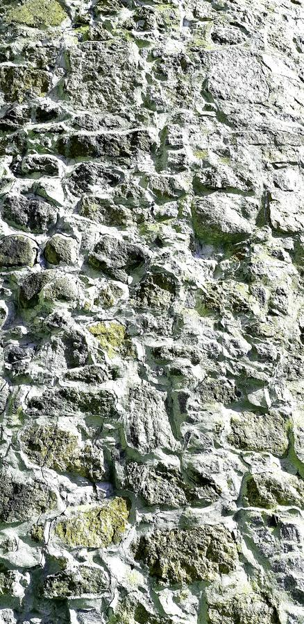Photo of a masonry building. Texture close up vertical.  Path in the park. Photo of a masonry building. Texture close up vertical. Natural material. Path in the stock image