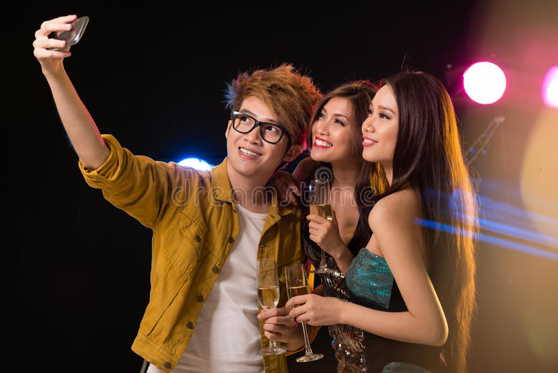 Photo for memory. Youngsters making a photo for memory in the nightclub royalty free stock photos
