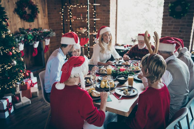 Photo of merry christmas family meeting with small little kids mature pensioner retired people sit table with x-mas. Photo of merry christmas family meeting with stock photos