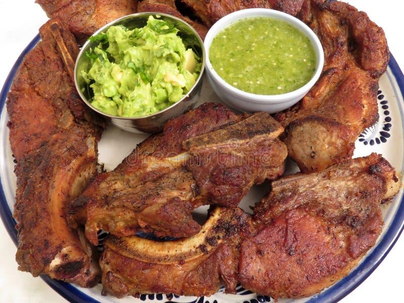 Pork Ribs With Guacamole and Tomatillo Sasla royalty free stock photo