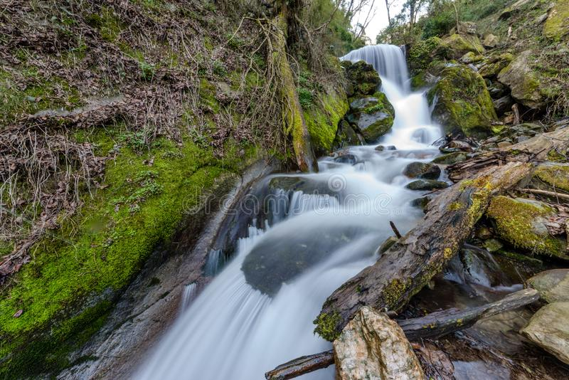 Photo of milky water stream in himalayas - waterfall. InIndia royalty free stock photography