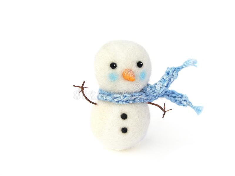 Photo Miniature fake snowman with blue scarf on white background. Photo for illustration of Christmas and New Year`s toy. Dollhous royalty free stock images