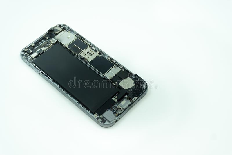 Photo of a mobile phone with broken display. Isolated on white with copy space royalty free stock photo