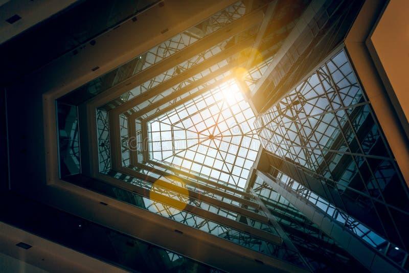 Photo of modern building atrium with shining sun. Interior photo of modern building atrium with shining sun stock image