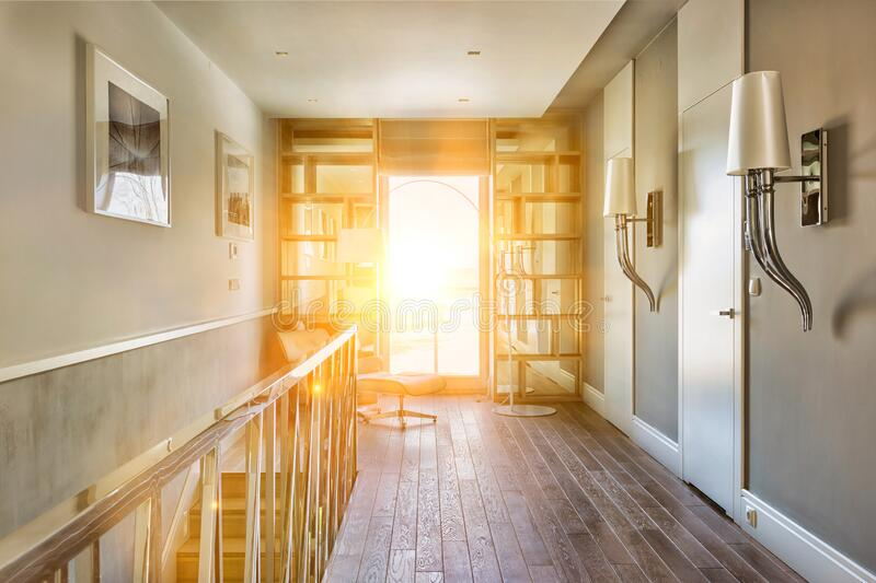 Photo of modern rental apartment interior with lens flare. Modern rental apartment interior with lens flare royalty free stock images