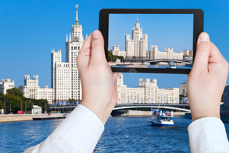 Photo of Moscow cityscape in sunny day. Travel concept - tourist taking photo of Moscow cityscape with Stalin's high-rise building on kotelnicheskaya embankment royalty free stock photos