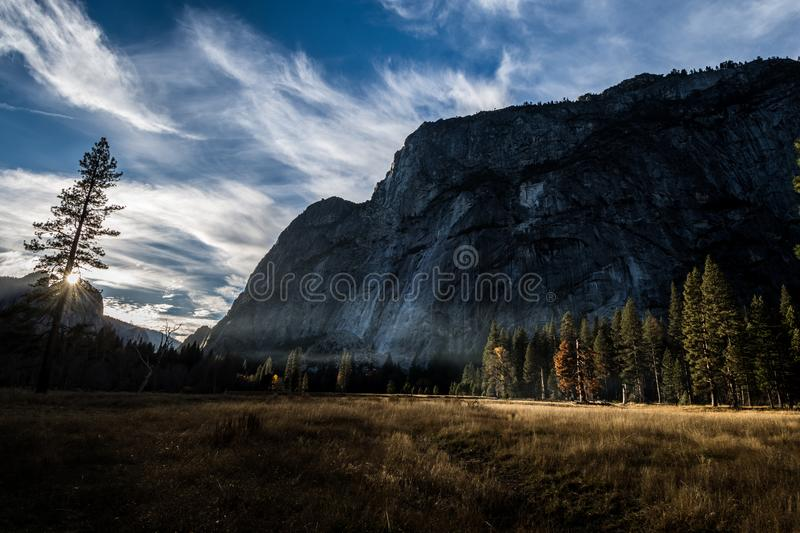 Photo of Mountain and Trees Under Cloudy Skies royalty free stock images