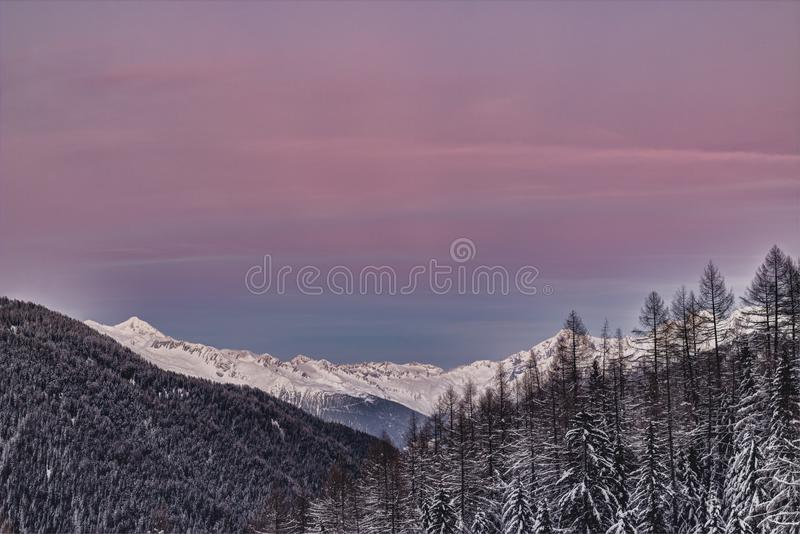 Photo of Mountains Covered with Snow and Surrounded with Trees royalty free stock image