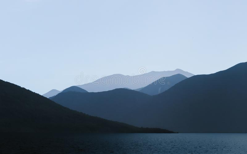 Photo of Mountains Near Body of Water stock photography
