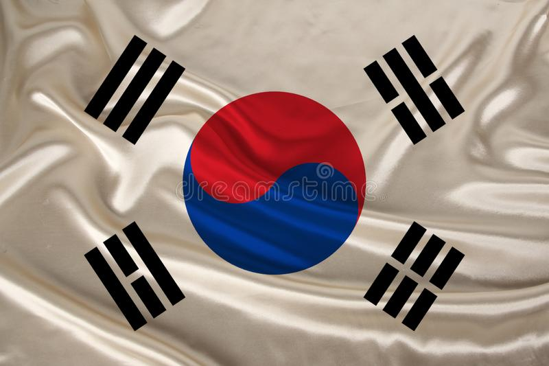 Photo of the national flag of South Korea on a luxurious texture of satin, silk with waves, folds and highlights, close-up, copy stock photos