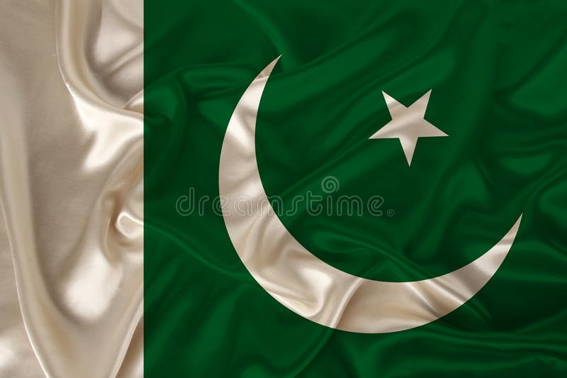 Photo of the national flag of the state of Pakistan on a luxurious texture of satin, silk with waves, folds and highlights, royalty free stock images