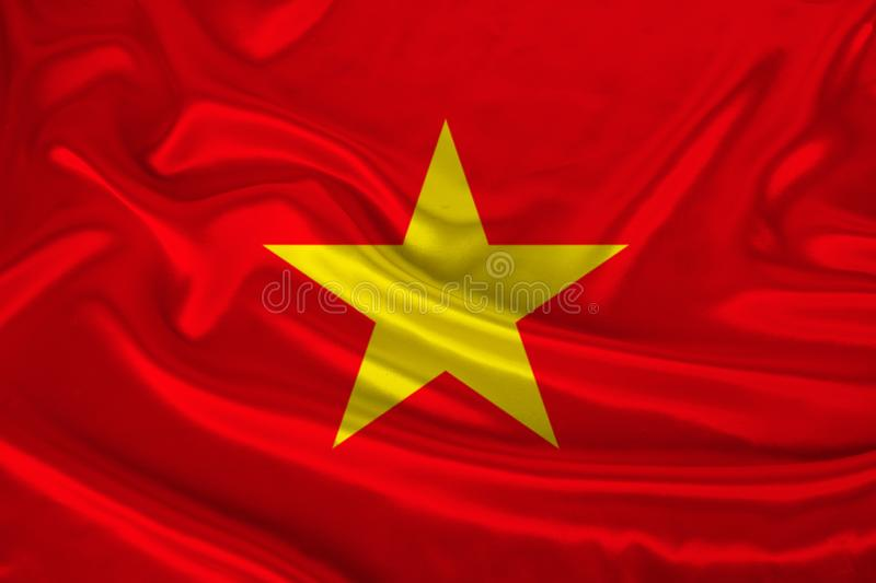 Photo of the national flag of Vietnam on a luxurious texture of satin, silk with waves, folds and highlights, close-up, copy space royalty free stock images
