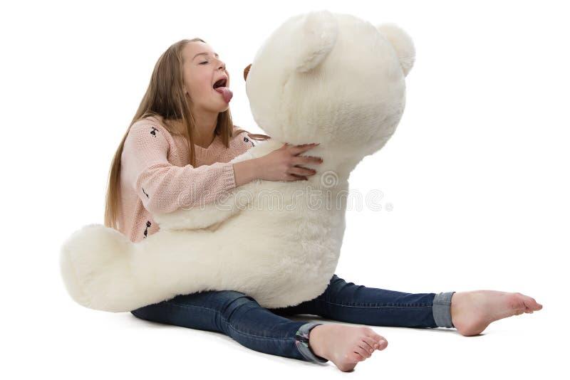Photo of naughty teenage girl with teddy bear stock photo