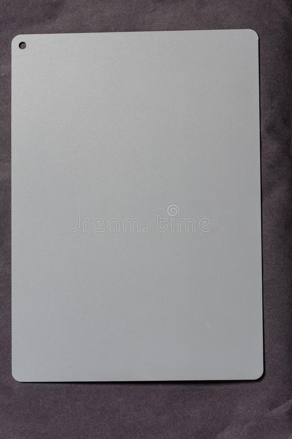 Photo of a neutral gray card for measuring white balance in the camera stock image
