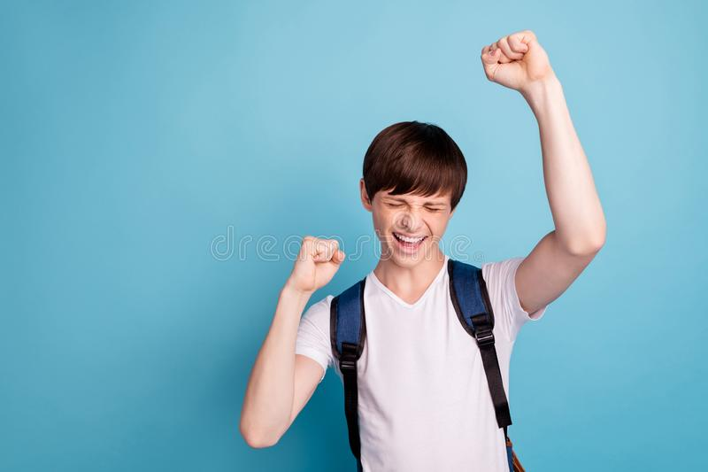 Photo of nice cheerful cute boy having got excellent mark at school while isolated with blue background stock photography